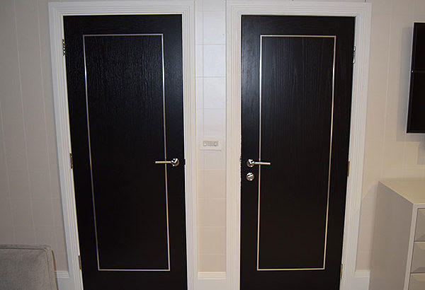 black oak door chrome inlays decorative steel
