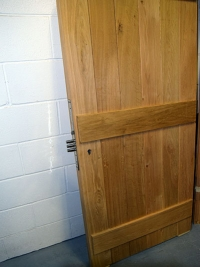oak-security-door-sloping-top-rear