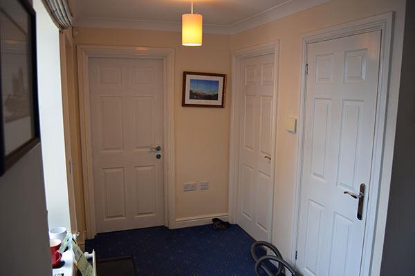 Stunning 6 panel wood grained security door - Henleys Security Doors