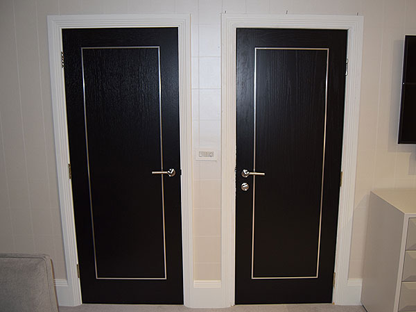 black oak door chrome inlays decorative steel